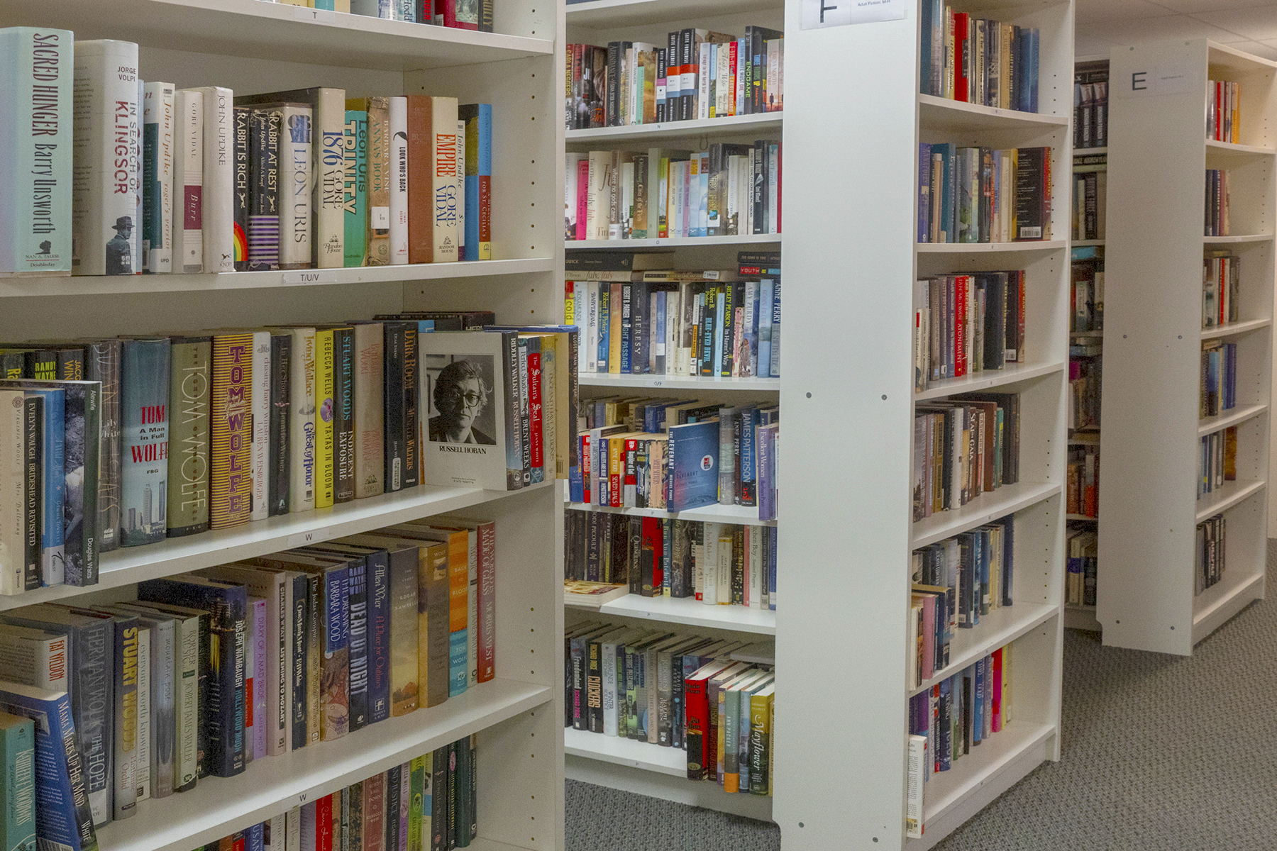 Rows of shelves fill the NHR Book Bank.