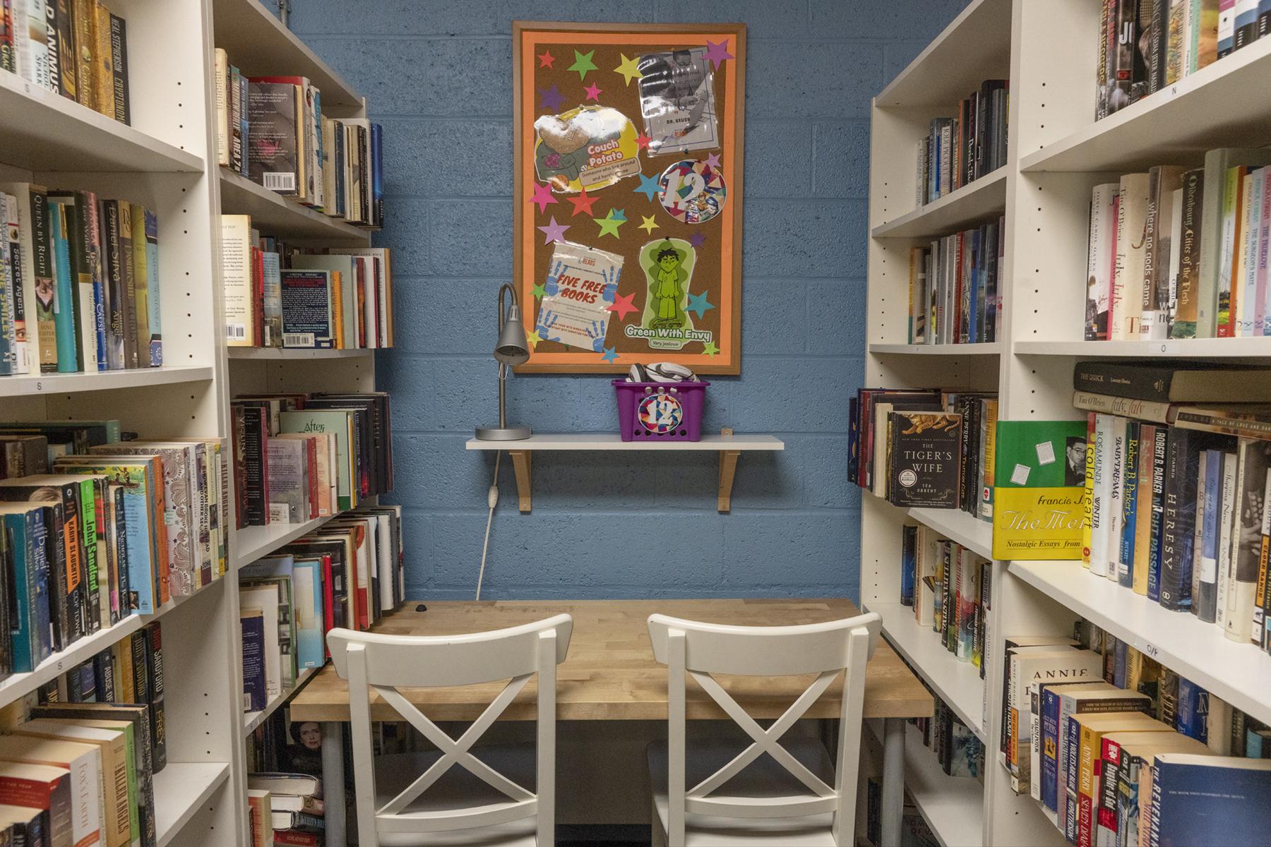 NHR tutoring station surrounded by bookshelves.