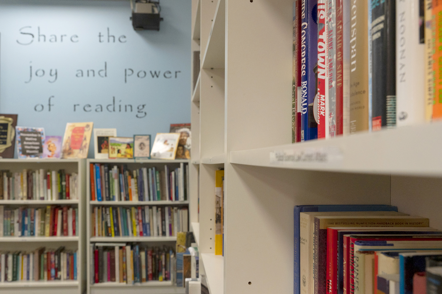 Shelves full of books line the front room of the NHR Book Bank.
