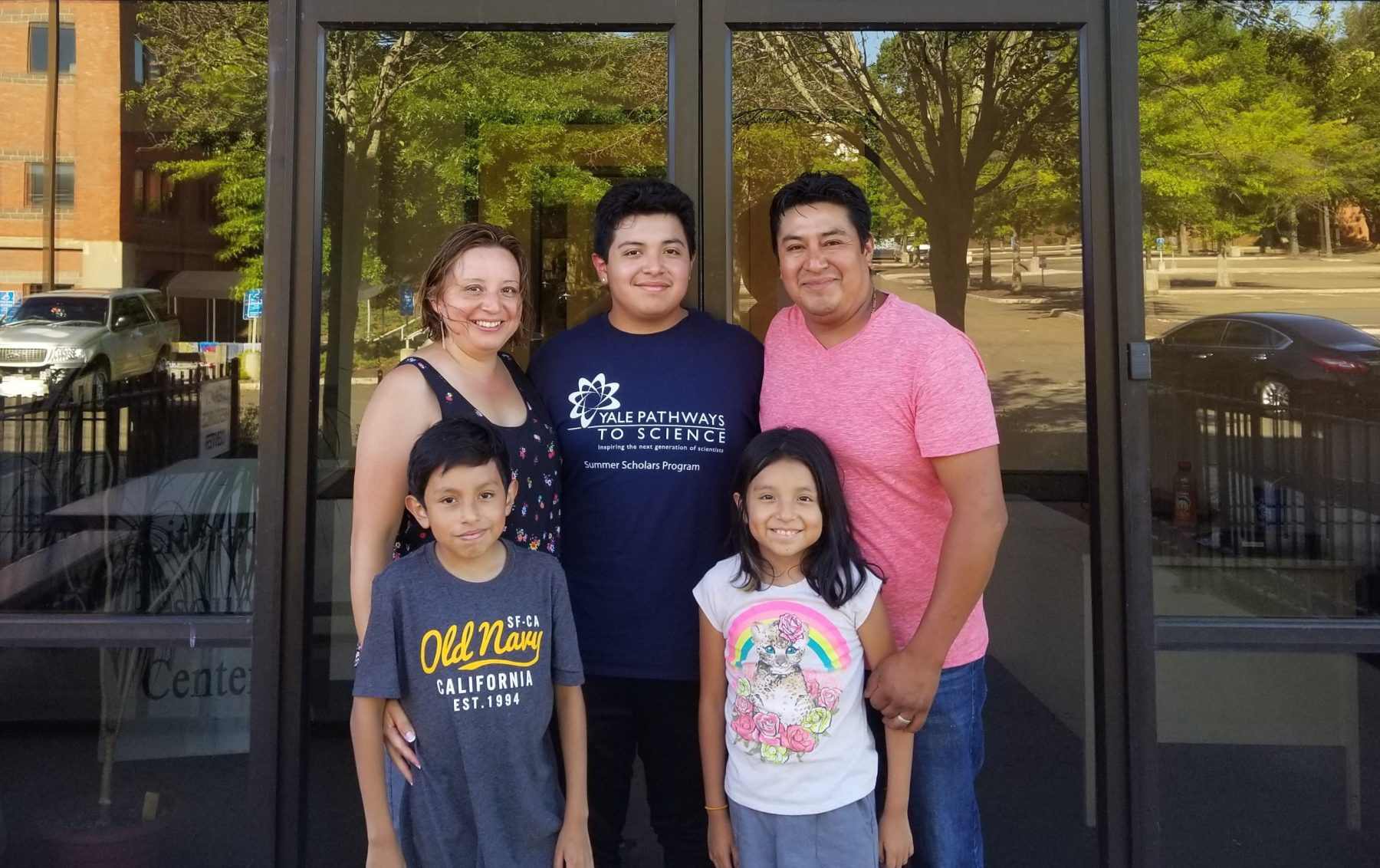 The Perez family stand outside a NHR location.