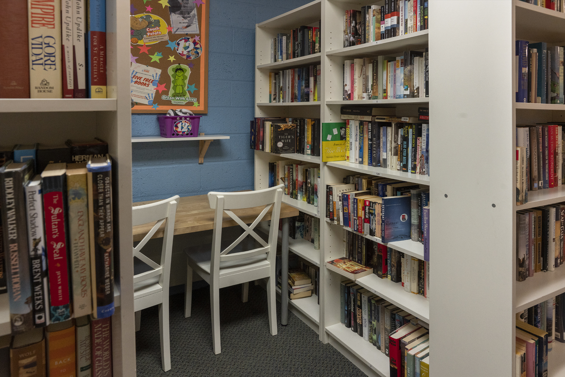 A tutoring station surrounded by bookshelves