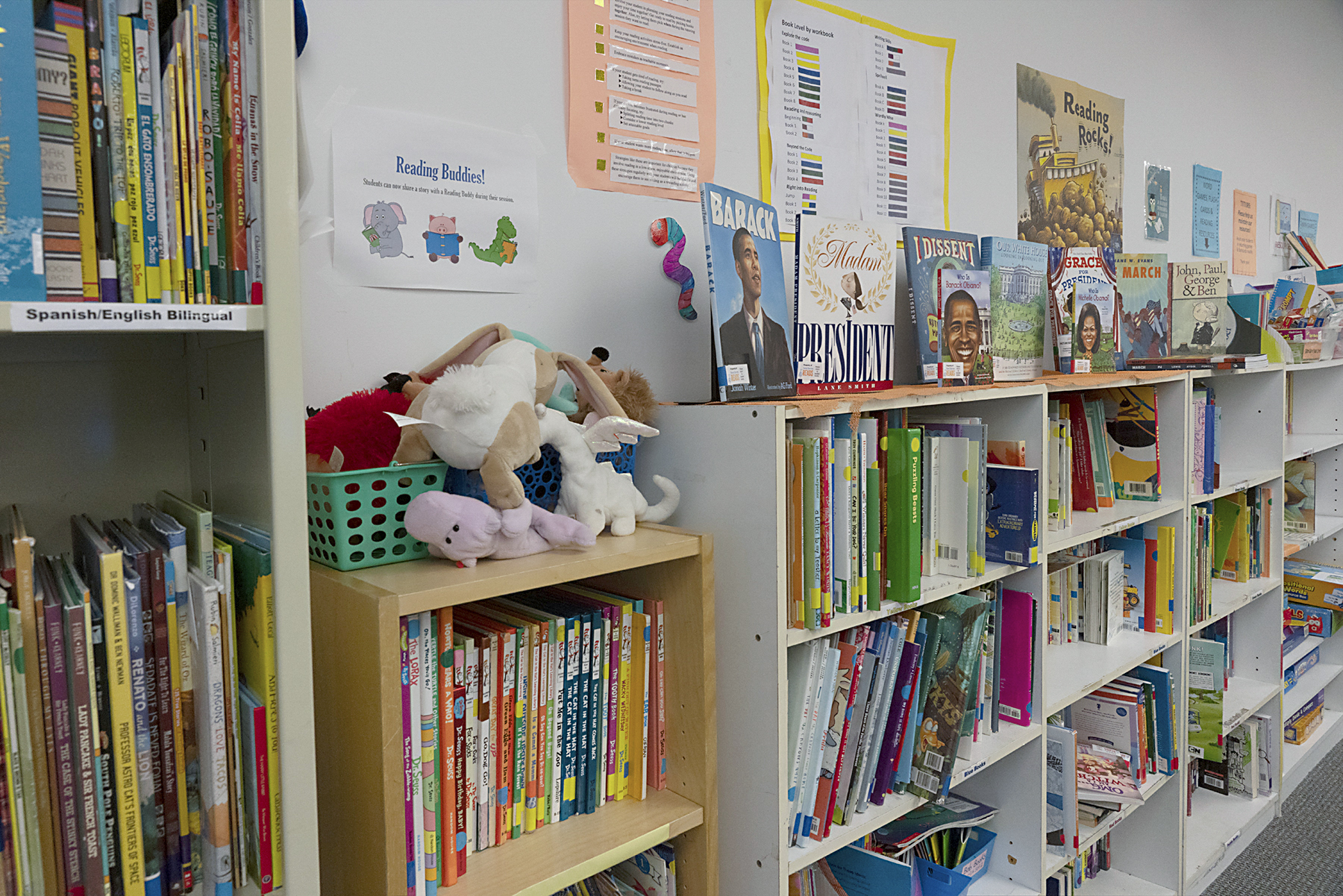 Shelves full of books for students to choose from for the read-aloud portion of tutoring