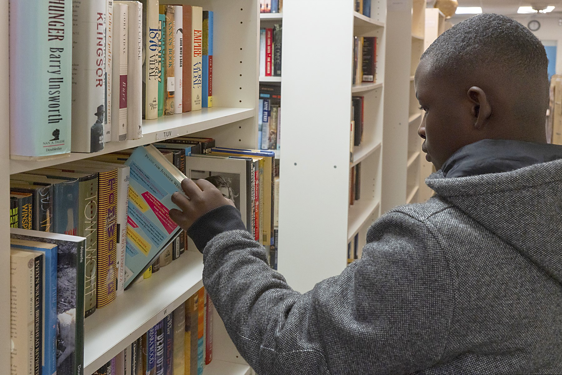 NHR student selects a book from the Book Bank.