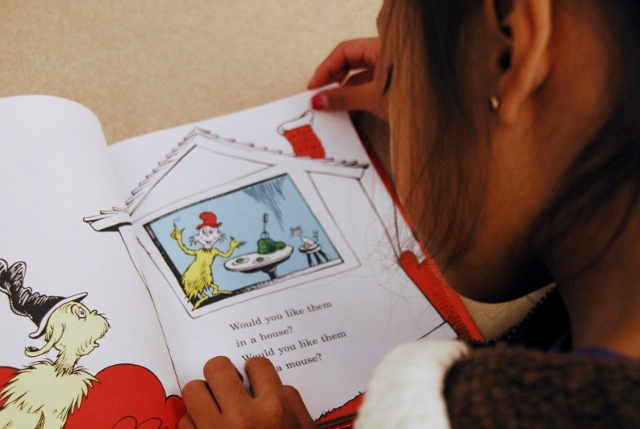 NHR student reads Dr. Seuss' Green Eggs and Ham.