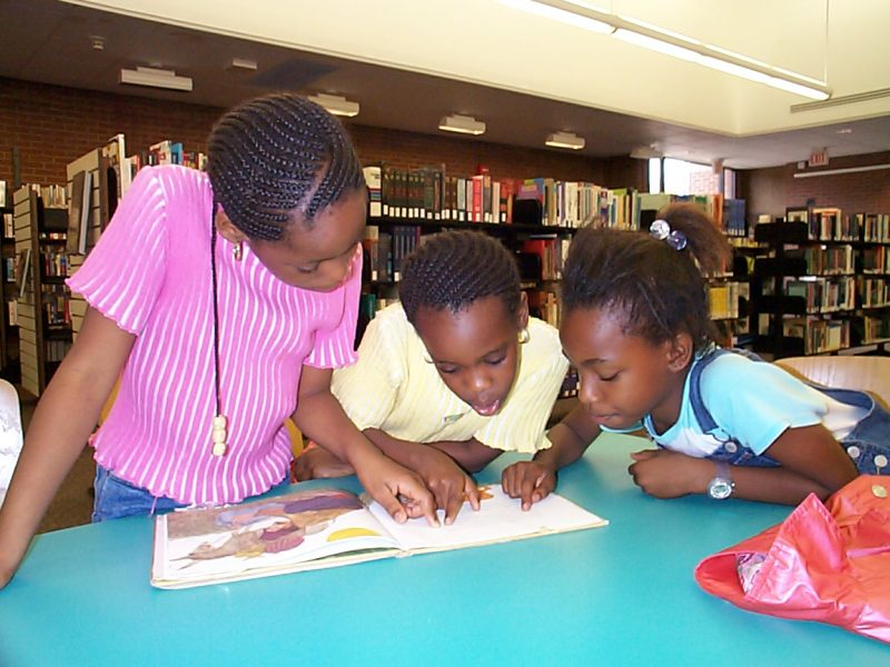 Three children read at New Haven Free Public Library Stetson branch