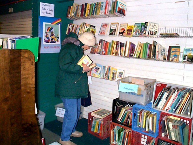 A patron selects books at the first book bank