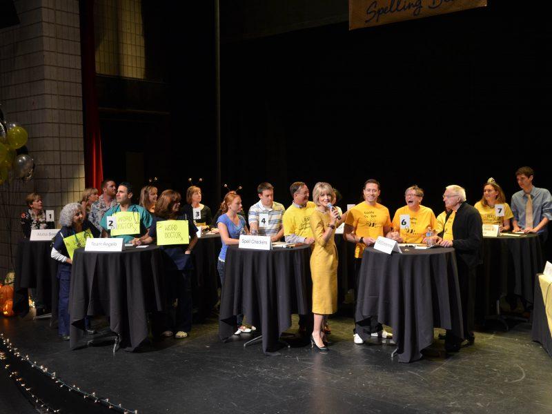 Ann Nyberg speaks to a Spelling Bee team