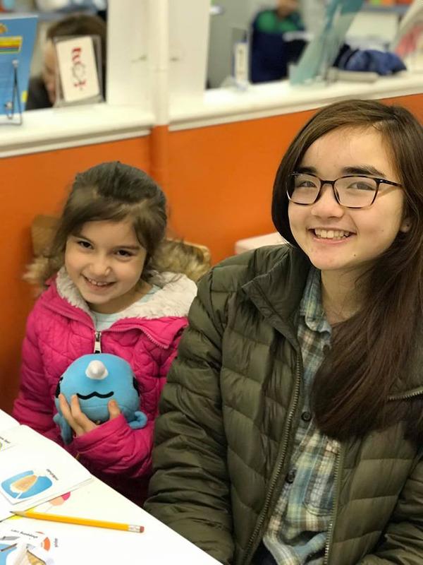 NHR Tutor Franziska L smiles with her student, Sukeyna M