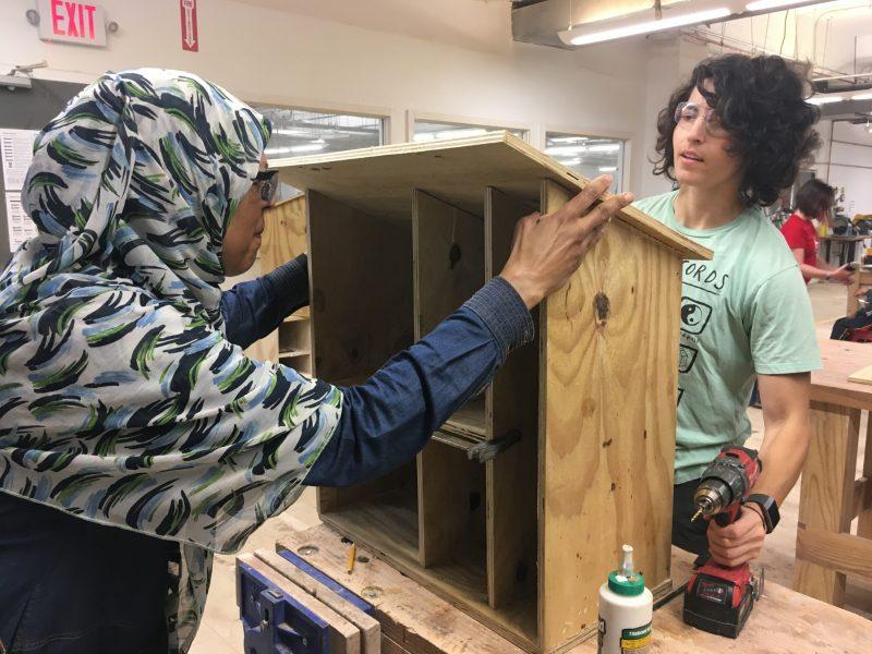 volunteers build a book box