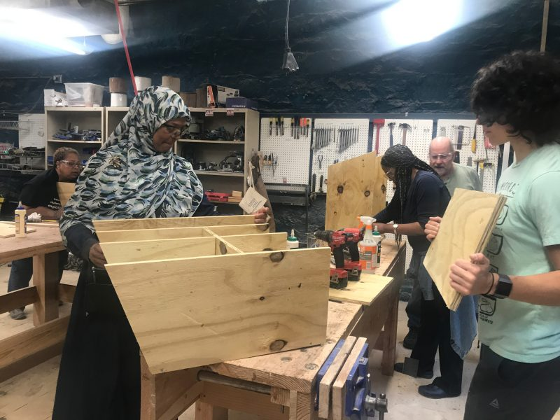 volunteers construct a book box