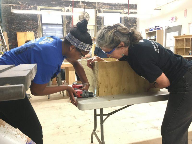 NHR staff construct a book box
