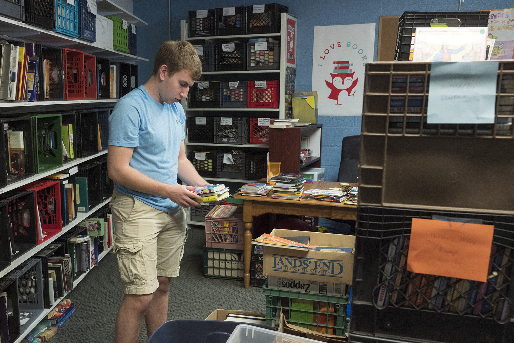 A volunteer sorts books in the book bank.