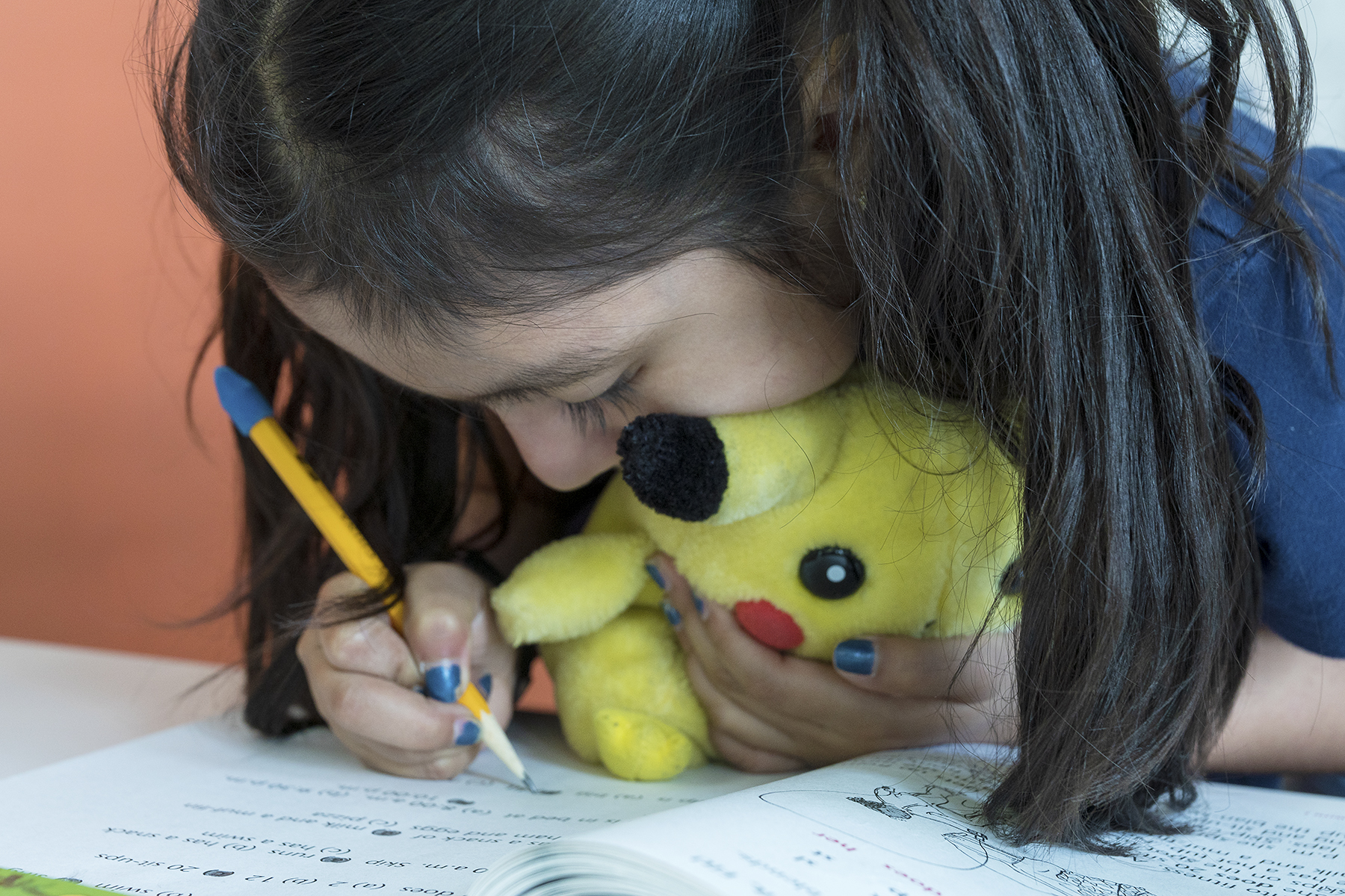 A student works in her workbook.
